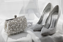 Glitter silver shoes and clutch bag Royalty Free Stock Image