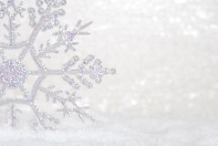 Glitter Snowflake in snow Royalty Free Stock Photography