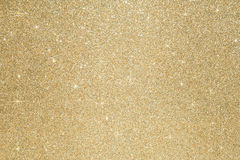 Glitter sparkle gold background Defocused abstract gold lights on background Royalty Free Stock Images