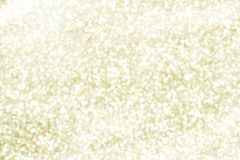Glitter sparkle gold background. Defocused abstract gold lights on background stock photography