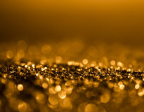 Glitter sparkle vintage lights background. dark gold and black. Royalty Free Stock Photo