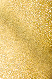 Glitter sparkles dust on background Royalty Free Stock Image