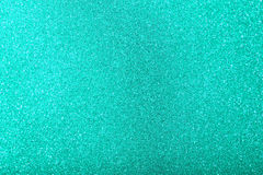 Glitter sparkles dust on background Stock Image
