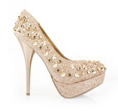Glitter spiked gold shoe Royalty Free Stock Photo