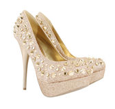 Glitter spiked golden shoes Stock Photography