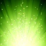 Glitter stars on green light burst