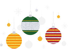 Glitter Stripe Christmas Ornaments. Three Christmas ball ornaments decorated with silver and gold glitter stripes with smaller silver and gold ornaments in the Stock Photography