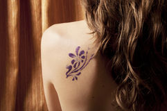 Glitter tattoo royalty free stock photography
