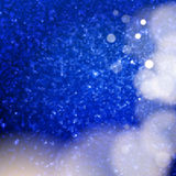 Glitter texture with glows and bokeh Royalty Free Stock Photography