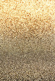 Glitter vintage golden lights background. Beautiful Christmas Gl. Ittering sparkles dust on background, shallow DOF Royalty Free Stock Photography