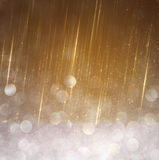Glitter vintage lights background. abstract gold background. defocused. Royalty Free Stock Images