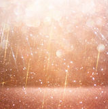 Glitter vintage lights background. abstract gold background. defocused.  Royalty Free Stock Photo