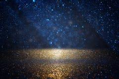 Free Glitter Vintage Lights Background. Black, Blue And Gold. De-focused. Royalty Free Stock Images - 125714379