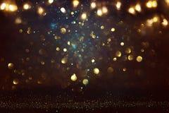 glitter vintage lights background. black, blue and gold. de-focused. stock photo