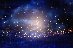 Glitter vintage lights background. black, blue, purple and gold. de-focused. Glitter vintage lights background. black, blue, purple and gold. de-focused Royalty Free Stock Image