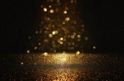 glitter vintage lights background. black and gold. de-focused. stock images