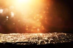 glitter vintage lights background. black and gold. de-focused, golden foil texture. Royalty Free Stock Images