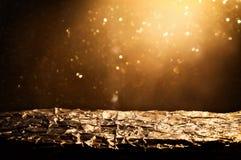glitter vintage lights background. black and gold. de-focused, golden foil texture. Royalty Free Stock Image
