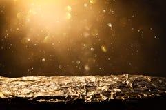 glitter vintage lights background. black and gold. de-focused, golden foil texture. Stock Photography