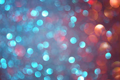 Glitter vintage lights background. blue, brown and purple mixed colors. defocused Royalty Free Stock Images