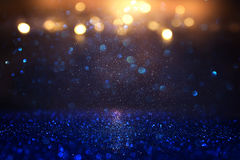 Glitter vintage lights background. blue, gold and black. de focused.  Stock Image