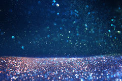 Glitter vintage lights background. blue, gold and black. de focused Stock Photos