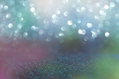 Glitter vintage lights background. blue, green and purple. defocused Stock Photos