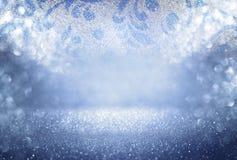 Glitter vintage lights background. blue, silver and black. defocused. stock image
