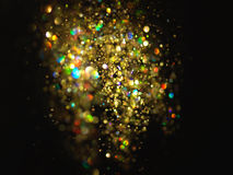 Glitter vintage lights background. dark gold and black. Christmas card. Glitter vintage lights background. dark gold and black. defocused. Christmas card Royalty Free Stock Photography