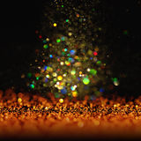 Glitter vintage lights background. dark gold and black. Christmas card. Glitter vintage lights background. dark gold and black. defocused. Christmas card Royalty Free Stock Photo