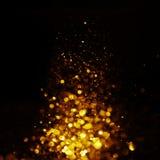 Glitter vintage lights background. dark gold and black. Christmas card. Glitter vintage lights background. dark gold and black. defocused. Christmas card Royalty Free Stock Image