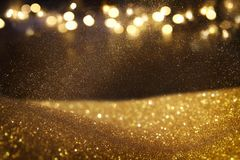 Glitter vintage lights background. dark gold and black. de focused. Stock Photography