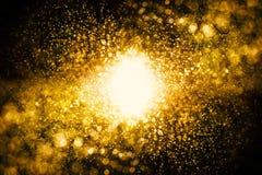 Glitter vintage lights background. dark gold and black. defocuse Royalty Free Stock Photo