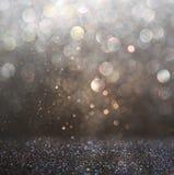 Glitter vintage lights background. dark gold and black. defocused. Royalty Free Stock Images