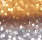 Glitter vintage lights background. dark gold and black. defocused Royalty Free Stock Photos