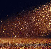 Glitter vintage lights background. dark gold and black. defocused.  Royalty Free Stock Photography