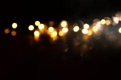 Glitter vintage lights background. de focused Stock Image