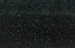 Glitter vintage lights background. defocused. Black glittery surface Royalty Free Stock Images