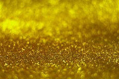 Glitter vintage lights background. defocused. Golden glittery surface Stock Photos