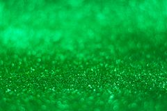 Glitter vintage lights background. defocused. Green glittery surface Royalty Free Stock Photo