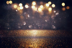 Glitter vintage lights background. gold and black. De-focused Royalty Free Stock Image