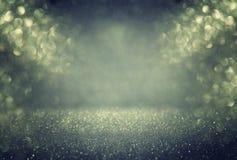 Glitter vintage lights background. gold, green and black. defocused. Stock Images