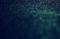 Glitter vintage lights background. gold, green, blue and black. de-focused. Stock Image