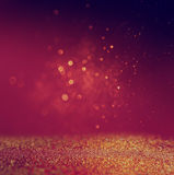 Glitter vintage lights background. gold, red and purple. defocused Stock Photography