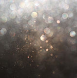 Glitter vintage lights background. gold, silver, and black. de-focused Royalty Free Stock Photography