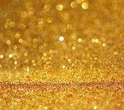 Glitter vintage lights background. gold, silver, and black. de-focused.. Royalty Free Stock Photography