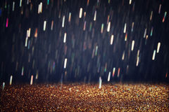Glitter vintage lights background. gold, silver, and black. de-focused.. Stock Photo