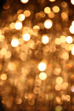 Glitter vintage lights background. gold, silver, and black. de-focused. Royalty Free Stock Photos