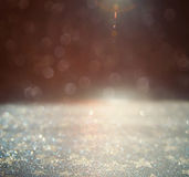 Glitter vintage lights background. gold, silver and black. defoc Stock Photos
