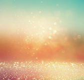 Glitter Vintage Lights Background. Gold, Silver, Blue And White. Abstract Blurred Image. Royalty Free Stock Photography
